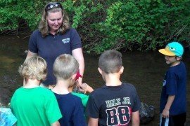 A group of youth learn about the importance of water clarity at a Penn State Extension program.