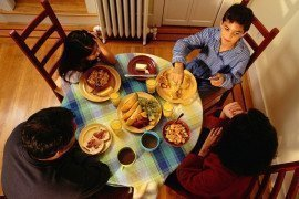 Author-Family_dinner- Family of four has dinner together. New USDA report examines the anti-poverty effects of the Supplemental Nutrition Assistance Program (SNAP). Photo: Thinkstock on flikr.com CC BY 2.0