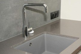 Ceramic kitchen sink. Air gap between faucet and flood rim of sink. bildlove/bigstock.com