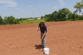 Collecting a soil sample to measure soil quality. Photo courtesy of Penn State Extension.