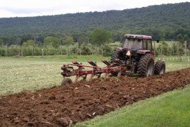Moldboard plowing, shown here, is a type of primary tillage. Photo courtesy of Penn State Extension