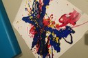 Once this art is displayed, a teacher can have conversations with toddlers about it, recalling how they swung a pendulum back and forth to create the arcs of color. (Art photo provided by Shannon Clarke, EC Educator, MacKids Learning Academy, Kansas City