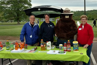 Master Gardeners Vince Fayock, Mary Jo Gibson and Ann Lee with Smokey the Bear at Family Safety Night