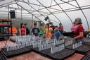 4-H Garden Club plants seeds in the greenhouse