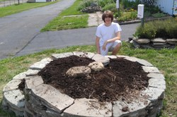 A local youth, Logan Sullivan, who helped Master Gardeners build the herb spiral garden at the Harford Fair grounds.